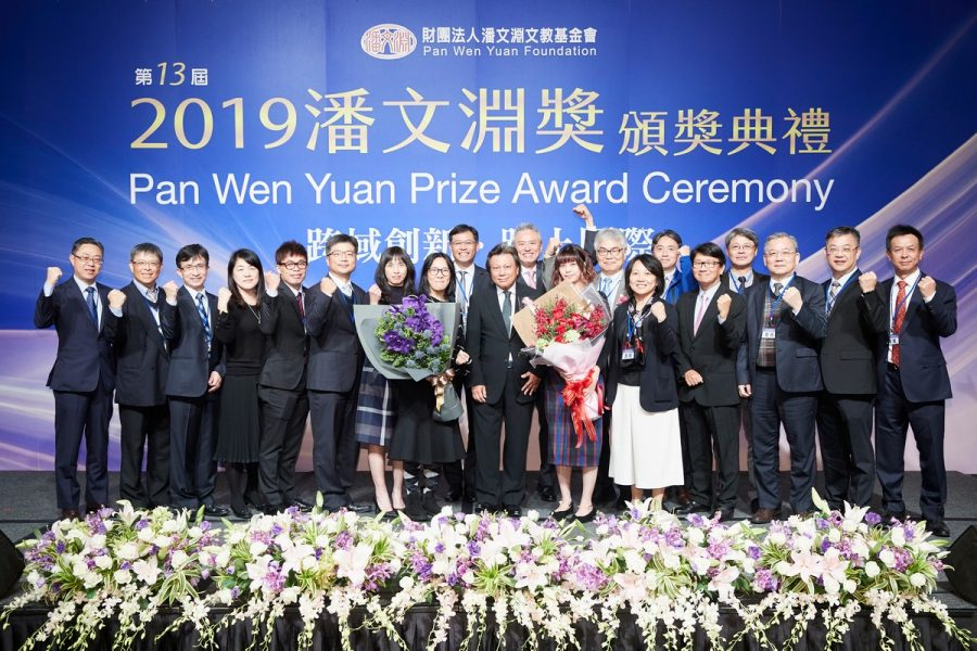 Hermes-Epitek employees present bouquets to Chairman Archie Hwang (front row center).